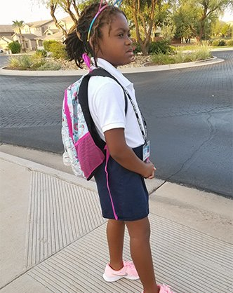 Valley Rose Educational Foundation backpack giveaway recipient