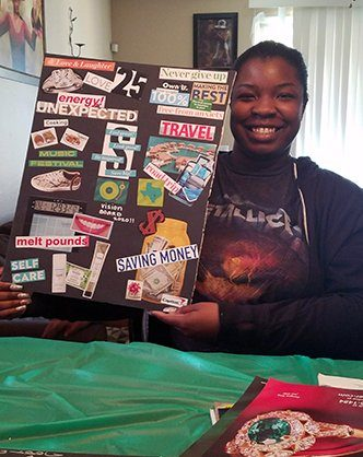 An empowered teen holding the vision board she just created