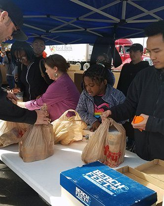 Valley Rose Educational Foundation handing out blessing bags